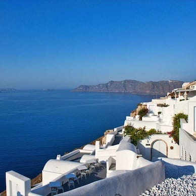 Canaves Oia blue sea clear sky white buildings Santorini Luxury Getaway Holiday Uniq Luxe