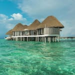 Maalifushi by COMO Maldives resort overwater villas on clear turquoise water Luxury Holiday Retreat Getaway Honeymoon Uniq Luxe
