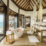 Maalifushi by COMO Maldives resort bathroom with sea view Luxury Holiday Retreat Getaway Honeymoon Uniq Luxe