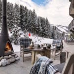 Relaxing at Aman Le Mélézin Ski Resort Terrace by the Bellecote Piste