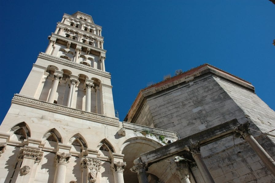 Tall and white Greek and European architecture towers over the city of Split, Croatia