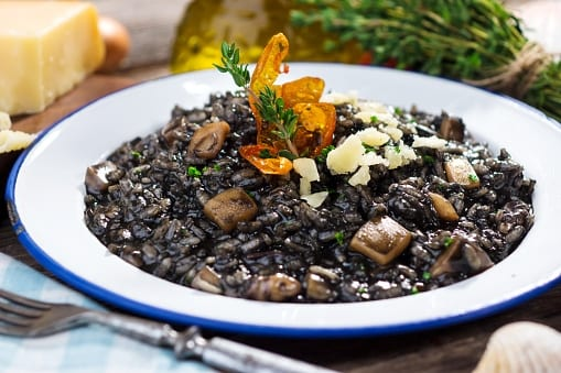 A plate of delicious squid-ink rice with seafood