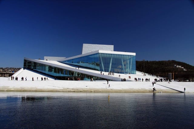 A pristine white building by a lake in Oslo, a must-see on a Norway luxury holiday.