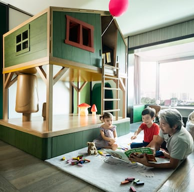 A father and his kids in their family suite for a family luxury staycation