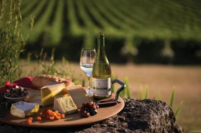 Yarra Valley's finest selection of berries, wine and cheese served on a platter - a tasty treat on your luxury travel to Oceania