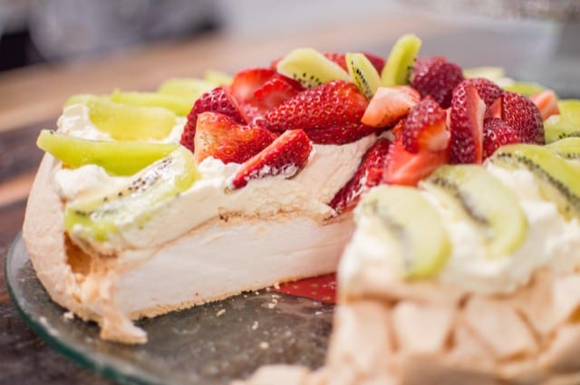 Pavlova is a delicious fruity dessert, topped with strawberries and kiwi, a gourmet speciality of New Zealand