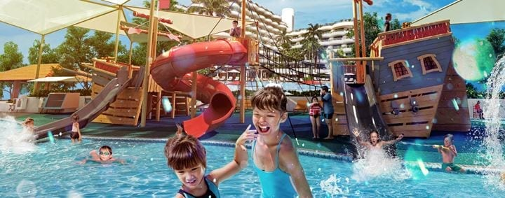 A waterplay area with a huge pirate ship, slides and water cannons to delight the kids on their luxury family staycation!