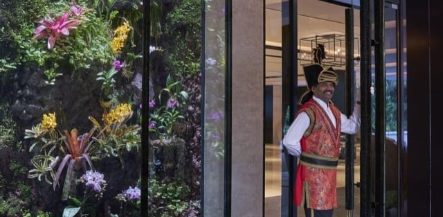 A friendly Shangri-La footman waits at the lobby entrance to greet you at the Tower Wing to begin your luxury staycation!