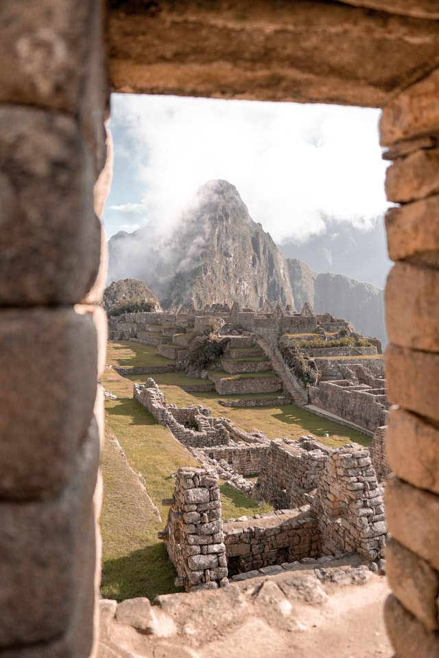 Glimpse the ancient citadel of Machu Picchu nestled at the peak of a mountain in Peru, a must-see sight on your North American luxury travels.