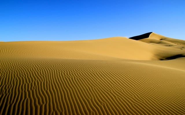 An endless stretch of sand across the land beneath the big blue sky- an unmissable sight for luxury travellers in Asia!