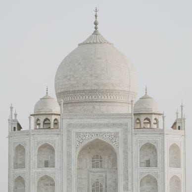 The Taj Mahal, a beautiful white palace and the gem of India - a must-go on your Asia luxury travel!