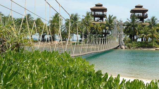 Take Palawan Beach's ropeway adventure bridge across for an interesting expedition on your luxury Sentosa staycation